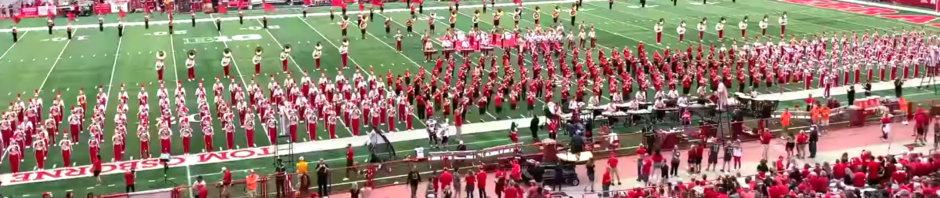 Marching band performing halftime on the field